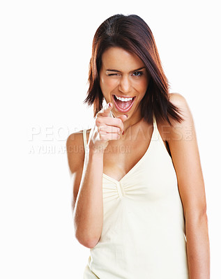 Buy stock photo Only you - Portrait of a happy young woman winks as she points her finger to you