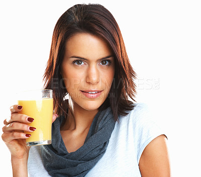 Buy stock photo Sensuous young woman with a glass of fresh orange juice over white background