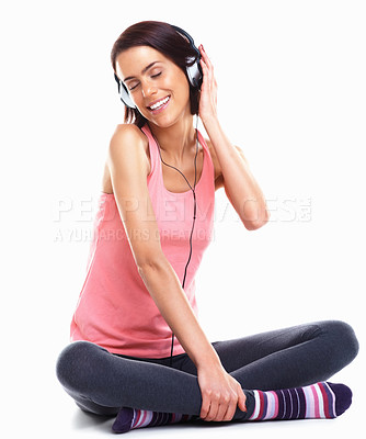 Buy stock photo Young relaxed woman listen and enjoys music against white background