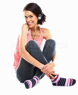 Buy stock photo Portrait of a happy relaxed female listening to music against white background