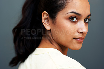 Buy stock photo Closeup portrait of a cute young female looking at you with an attitude against grey background