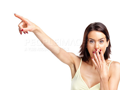 Buy stock photo Portrait of a surprised young female pointing towards copyspace against white background