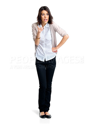 Buy stock photo Portrait of a beautiful young woman pointing her finger at copyspace over white background
