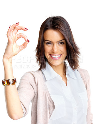 Buy stock photo Portrait of a  smiling young female showing okay sign against white background