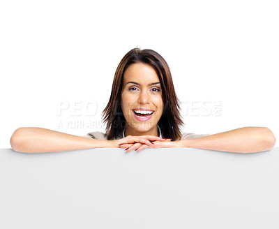Buy stock photo Portrait of an smiling young female leaning on empty billboard against white bacKground