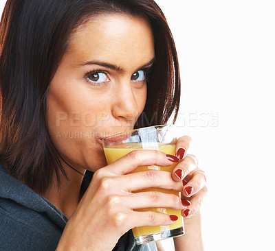 Buy stock photo Detail shot of a young woman drinking orange juice against white background