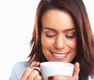 Buy stock photo Closeup image of a young woman enjoying the aroma of her drink against a white background