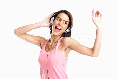 Buy stock photo Young attractive woman dancing to music with headphones against white background