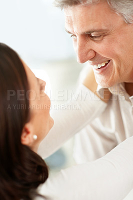 Buy stock photo Closeup portrait of romantic mature couple looking at each other and smiling
