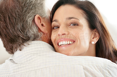 Buy stock photo Closeup portrait of a beautiful mature woman hugging her husband