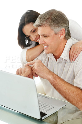Buy stock photo Portrait of a happy mature man showing something to her wife on laptop