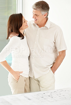 Buy stock photo Portrait of happy mature couple standing together and looking at each other