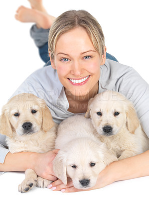 Buy stock photo Lying on floor with her pet dogs