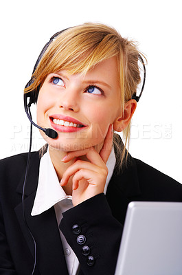Buy stock photo Close-up portrait of friendly secretary/telephone operator, looking up at the corner as contemplating something. Isolated on white background.