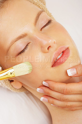 Buy stock photo Shot of a young woman enjoying a healthy skin treatment at a spa resort.