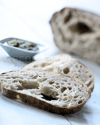 Buy stock photo Bread with Italian Pesto on the side. Simplistic european style