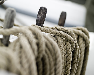 Buy stock photo Close-up shot of rope. Taken at a shipyard.