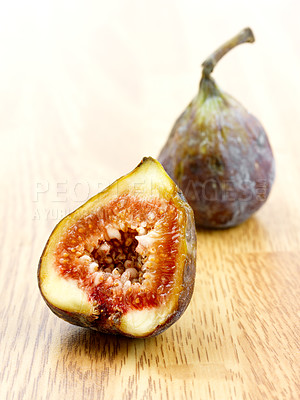 Buy stock photo Macro shot of a sliced fig on a table.