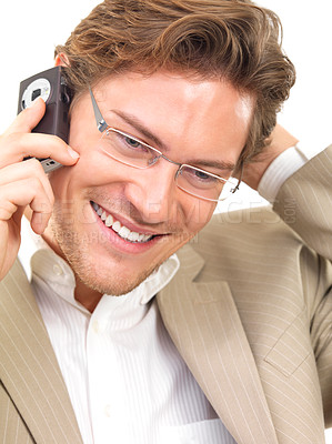 Buy stock photo Cheerful businessman using mobile phone against white background