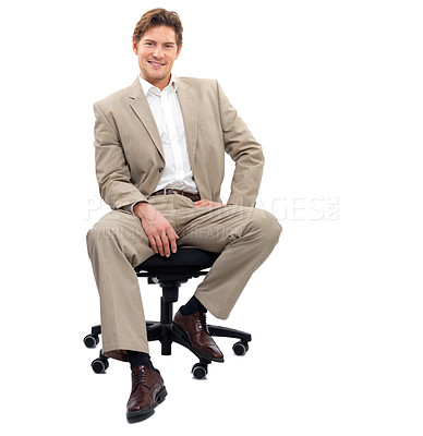 Buy stock photo Portrait of a cheerful young man sitting on chair against white background