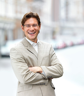 Buy stock photo Portrait of a cheerful businessman with arms crossed