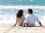 Couple sitting together on beach