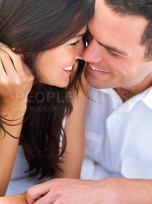 Buy stock photo Close up of a smiling young couple in love