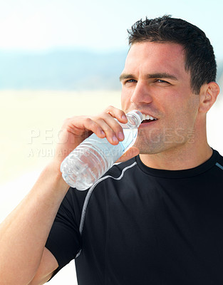 Buy stock photo Close up of a young man drinking bottle of water
