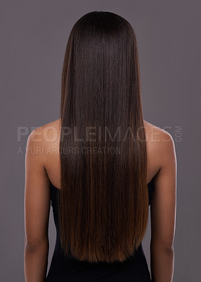 Buy stock photo Rear view of a young woman with beautiful long hair