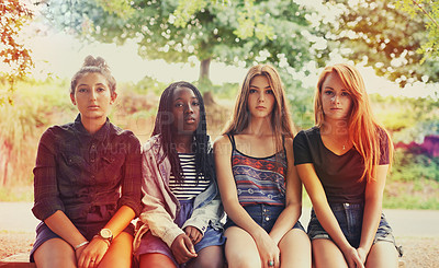 Buy stock photo Four young girls looking at the camera with a serious expression