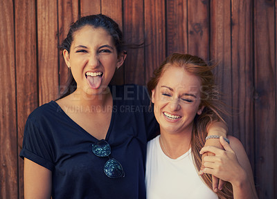 Buy stock photo Two beautiful young girls having fun while spending time together outside