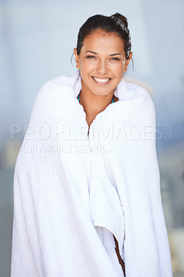 Buy stock photo Portrait of a beautiful young woman holding a towel around her body