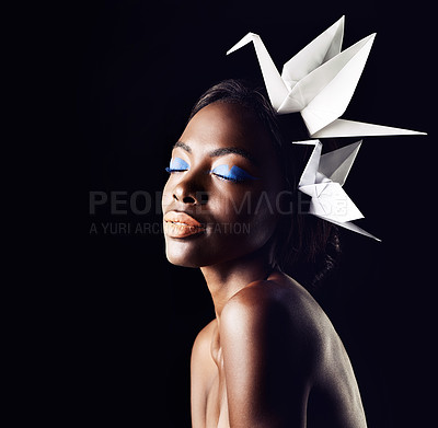 Buy stock photo Cropped shot of a beautiful ethnic woman posing with origami birds on her head