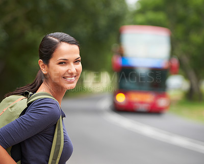Buy stock photo A beautiful young woman wearing a backpack while waiting for the bus
