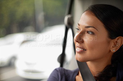Buy stock photo A beautiful woman looking out of her window while riding in a car