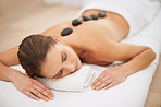 Unwinding with a hot stone massage