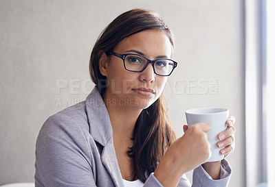 Buy stock photo Portrait of an attractive young businesswoman drinking coffee in her office