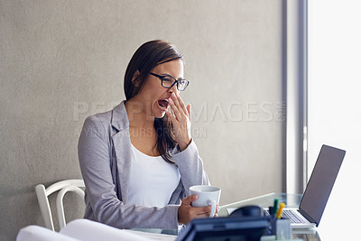 Buy stock photo An attractive young businesswoman yawning while sitting at her desk