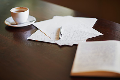Buy stock photo Shot of stationery and a cup of coffee on a desk