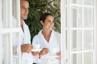 Buy stock photo Shot of a loving mature couple enjoying a cup of coffee at a day spa