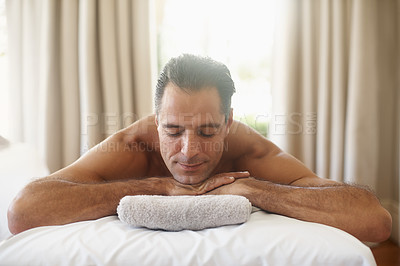 Buy stock photo Shot of a mature man resting on a massage table
