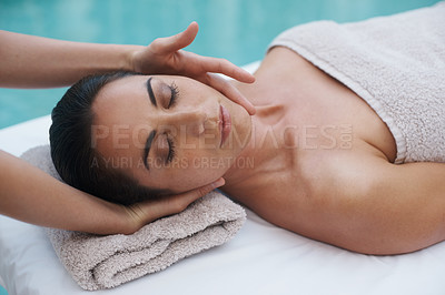 Buy stock photo Shot of a woman lying on a massage table getting treated to a massage