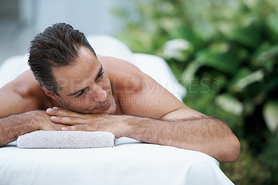 Buy stock photo Cropped shot of a handsome man lying on a massage table