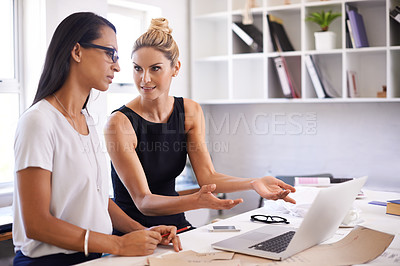 Buy stock photo Shot of two beautiful woman working in a clothing boutique