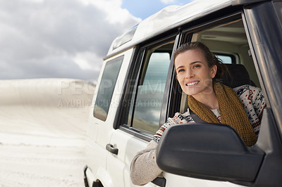 Buy stock photo Shot of an attractive young woman checking the horizon while on a roadtrip