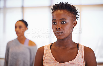 Buy stock photo Cropped shot of a young woman in a dance studio