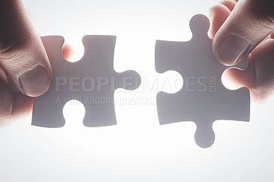 Buy stock photo Cropped shot of hands holding two puzzle pieces