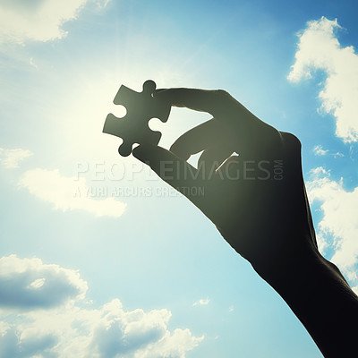 Buy stock photo Conceptual shot of a person's hand building a puzzle