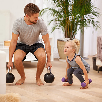 Buy stock photo Full length shot of a father and daughter working out together