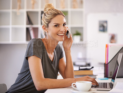Buy stock photo A beautiful young businesswoman speaking on the phone while working on her laptop